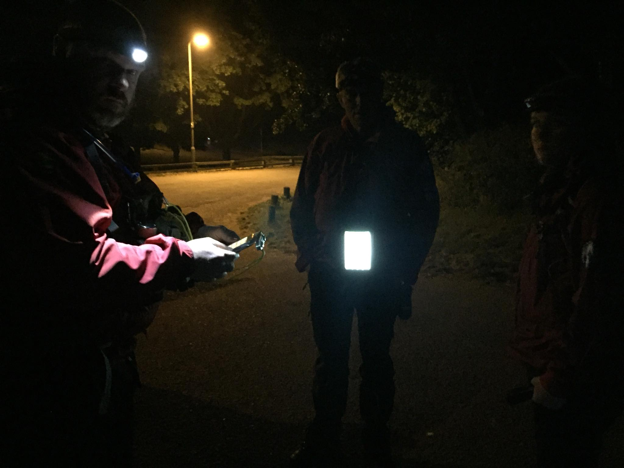 Team members checking search maps in advance of the search in Exeter