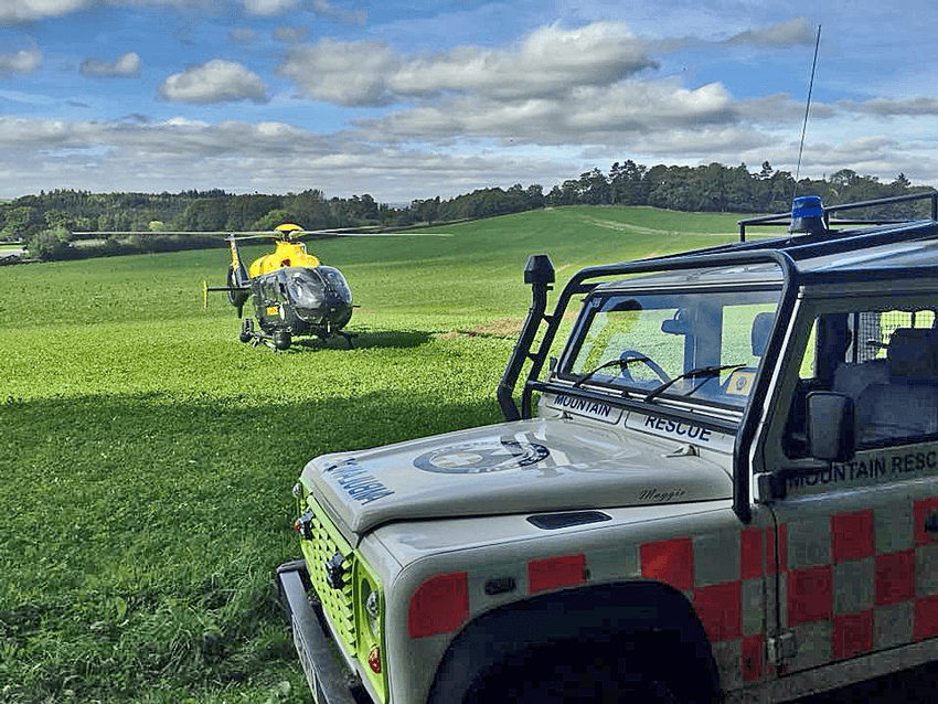 Police helicopter on site ready to collect a casualty from Dartmoor Search and Rescue Ashburton