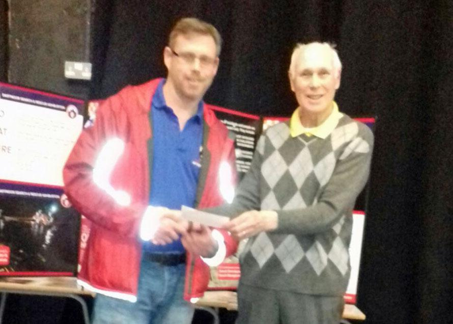 Mark Pickering receiving a cheque from Ivybridge Short Mat Bowls secretary John Chaplin