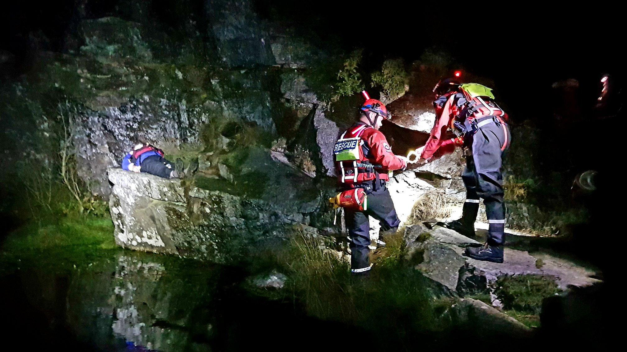 Dartmoor Rescuers begin to enter the water at Haytor Quarry to reach a casualty